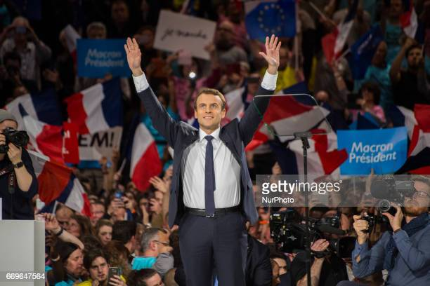 French candidate of En Marche, Emmanuel Macron delivers a speech during his last rally campaign before the first round of 2017 French Presidential...