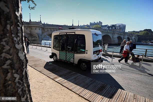 A French capital's transport authority RATP electricpowered driverless EZ10 minibus able to carry up to 12 passengers carries out its first test on...