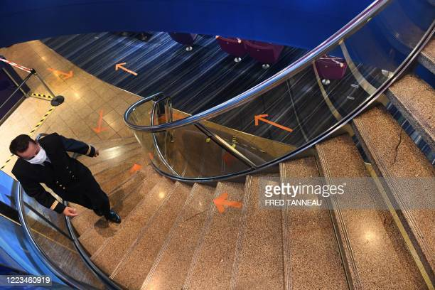 French captain Arnaud Roux walks up the stairs on the ferry Armorique of Brittany Ferries company in the port of Roscoff western France on June 29...