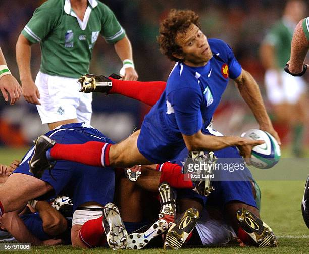 French captain Fabien Galthie passes from the back of the scrum during the France V Ireland quarter final Rugby World Cup 2003 match won 4321 by...