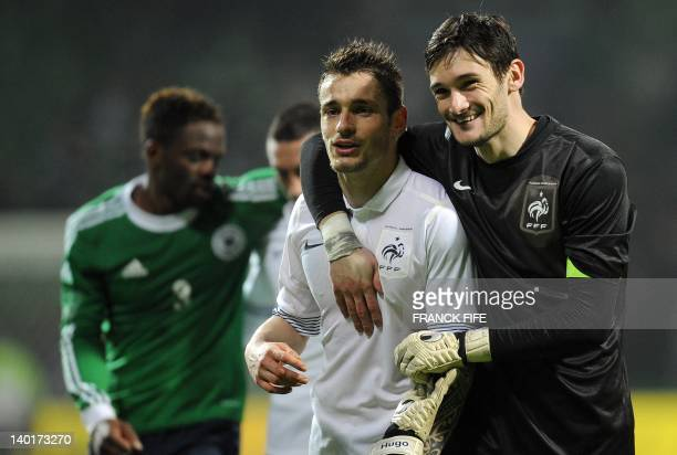 French captain Hugo Lloris and defender Mathieu Debuchy react after the International friendly football match Germany vs France in the northern...