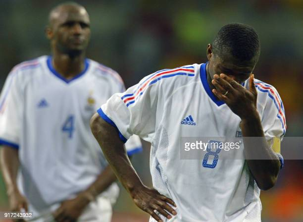 French captain Marcel Desailly reacts as Patrick Vieira follows, 06 June 2002 at the Busan Asiad Main Stadium in Busan, following the first round...