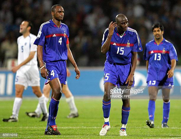 French captain Patrick Vieira Alou Diara and Vikash Dhorasoo react at the end of their WC2006 qualifying match 30 March 2005 against Israel at the...