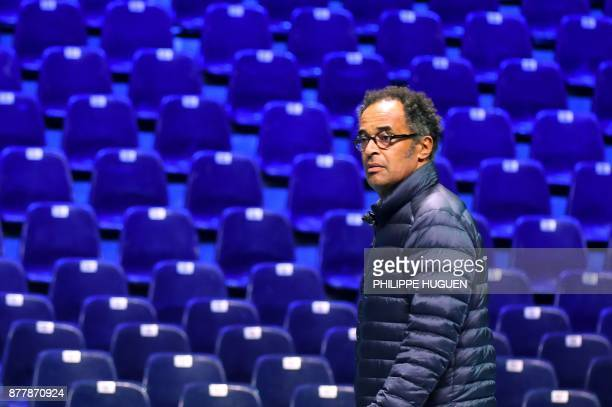 French captain Yannick Noah looks on during a training session on November 23 2017 at the PierreMauroy stadium in Villeneuve d'Ascq ahead of the...