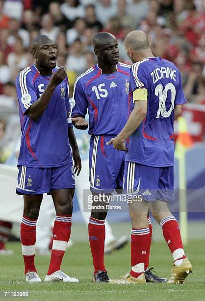 French Captain Zinedine Zidane argues with teammates Lilian Thuram and William Gallas during the FIFA World Cup Germany 2006 Group G match between...