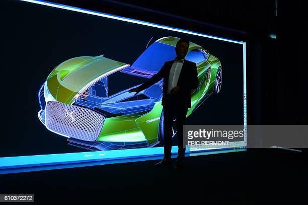 French carmaker DS design director Thierry Metroz gives presentation with a 3D rendering of the DS electric ETense Concept car on September 9 at the...
