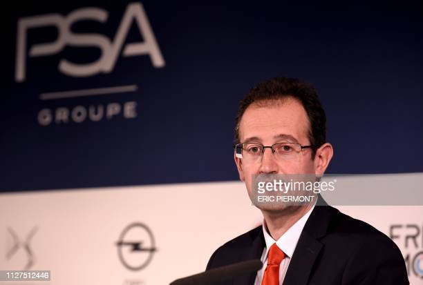 French carmaker PSA Groupe CFO Philippe de Rovira listens during the presentation of the group full year 2018 financial results at PSA Groupe...