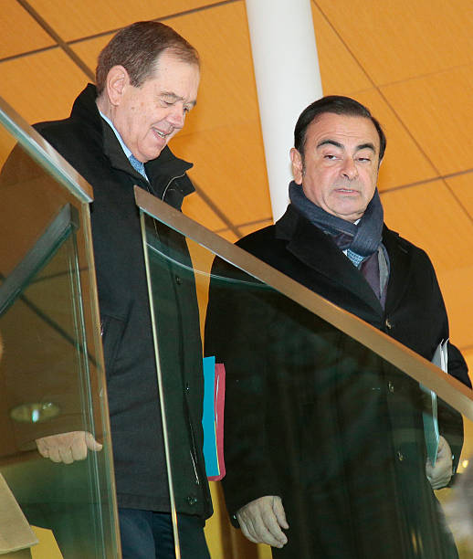 French Carmaker Renault CEO Carlos Ghosn (R) Arrives With