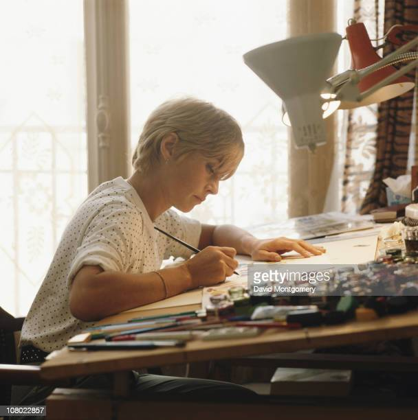 French cartoonist Claire Bretecher at work February 1981