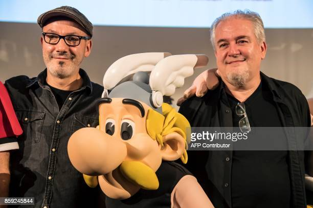 French cartoonist Didier Conrad and French writer and designer JeanYves Ferri pose with an effigy of comic book character Asterix during a press...