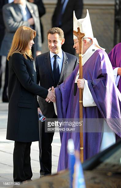 French Catholic Cardinal Andre XXIII French president Nicolas Sarkozy and his wife Carla are welcomed by French Catholic Cardinal Andre VingtTrois...