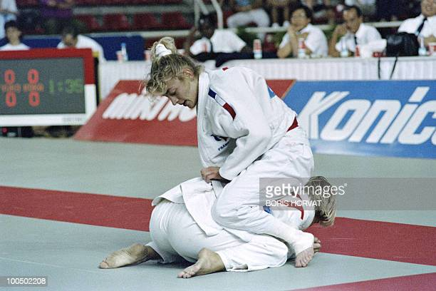 French Cecile Nowak and Austrian Michaela Bornemann fight during the World championships final in judo on July 28 in Barcelona AFP PHOTO BORIS HORVAT