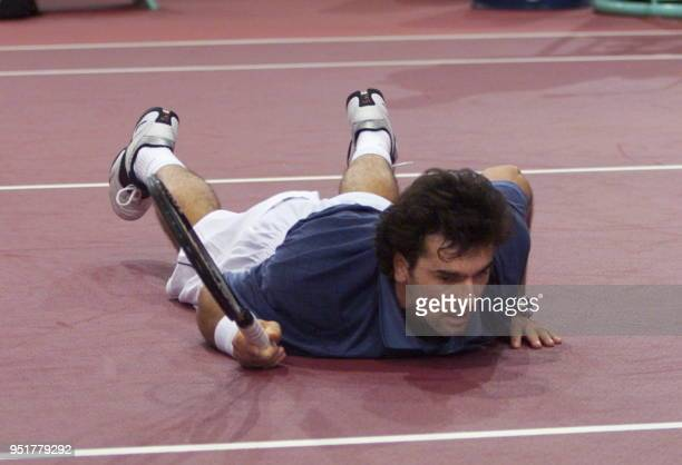 French Cedric Pioline falls during his match against Micheal Chang of the US during their quarterfinals of the ParisBercy Open 05 November 1999...
