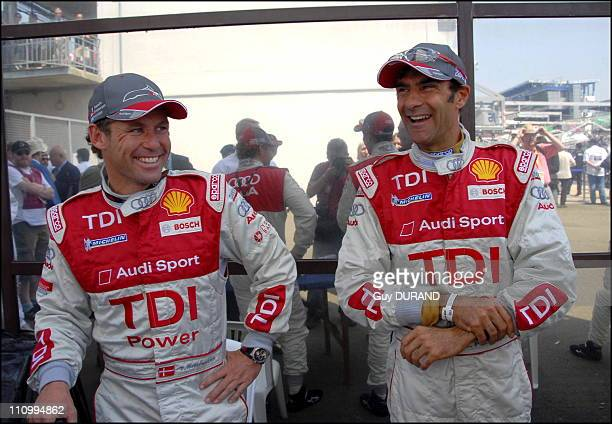 French celebrities at the '24 heures du Mans' race Audi driver Tom Kristensen and Emanuele Pirro in Le Mans France on June 17th 2006