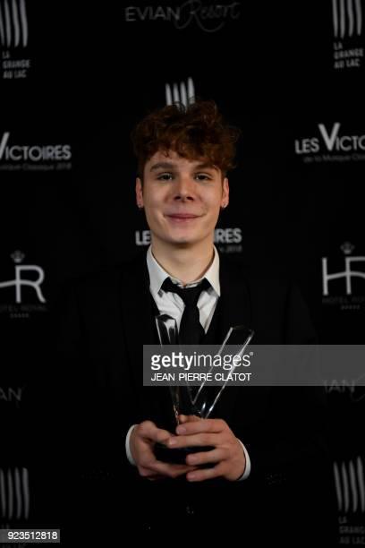French cellist Bruno Philippe poses after receiving an award at the 'Victoire de la musique classique' award ceremony at The Grange au Lac Auditorium...