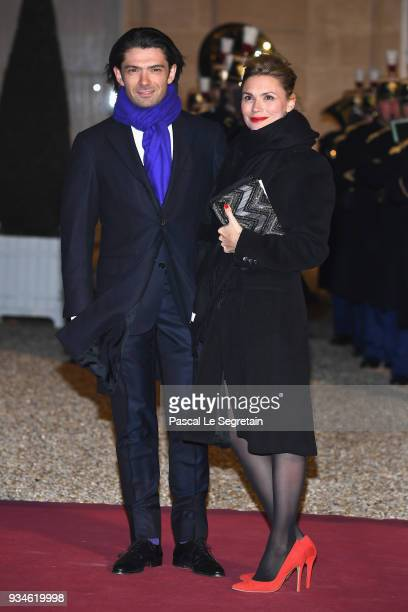 French cellist Gautier Capucon and Delphine Capucon attend a State dinner hosted by French President Emmanuel Macron and Brigitte Macron at the...