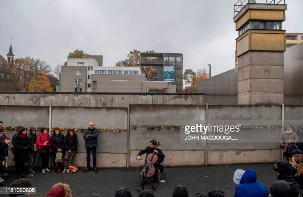French cellist Gautier Capucon performs at the Berlin Wall memorial, after official guests attended celebrations of the 30th anniversary of the fall...