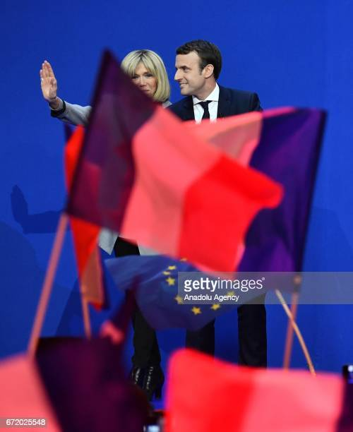 French centrist independent candidate Emmanuel Macron and his wife Brigitte Trogneux arrive for addressing supporters after winning the lead...