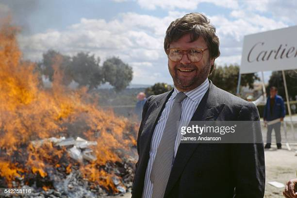 French CEO of Cartier Alain Dominique Perrin leading the media fight against the international counterfeit goods market by setting fire to fake...
