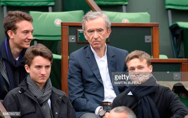 French CEO of luxury goods group LVMH Bernard Arnault attends the men's final match between Britain's Andy Murray and Serbia's Novak Djokovic at the...