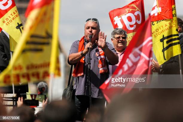 French CFDT trade union leader Didier Aubert addresses protesters during a gathering of employees of the stateowned rail operator SNCF called by CGT...