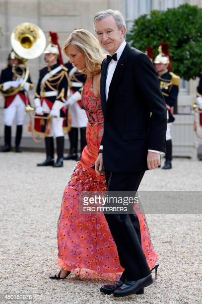 French chairman of luxury brand LVMH Bernard Arnault and his wife French piano soloist Helene MercierArnault arrive for a state dinner with world...