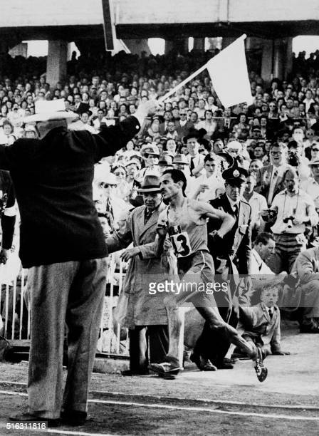 French champion Alain Mimoun runs the marathon event December 01 1956 at the Olympic stadium in Melbourne and wins the gold medal Mimoun won 32...