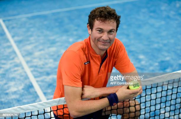 French Champion of Padel Jeremy Scatena poses for a picture during a padel match on October 10 2017 in Bois d'Arcy near Paris Tennis champions like...