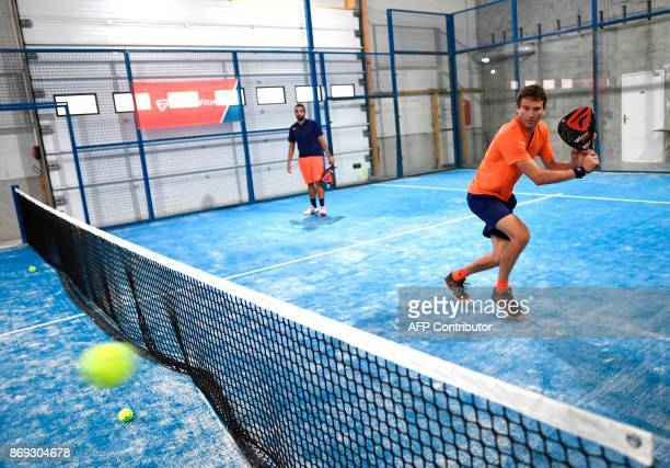 French Champion of Padel Jeremy Scatena prepares to return a ball during a padel match on October 10 2017 in Bois d'Arcy near Paris Tennis champions...