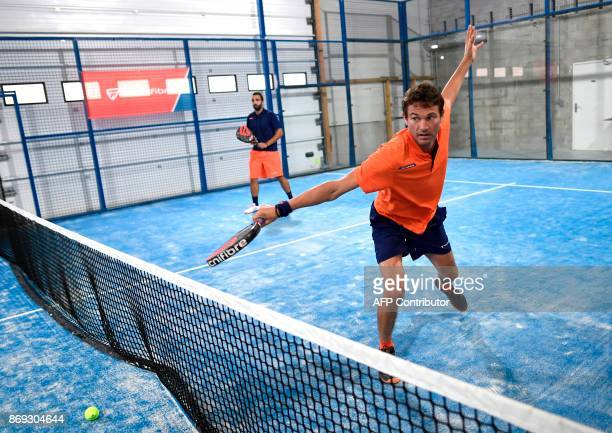 French Champion of Padel Jeremy Scatena returns a ball during a padel match on October 10 2017 in Bois d'Arcy near Paris Tennis champions like Nadal...