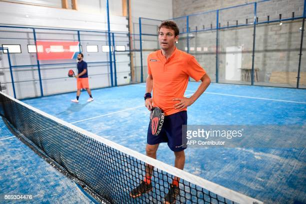 French Champion of Padel Jeremy Scatena stands during a padel match on October 10 2017 in Bois d'Arcy near Paris Tennis champions like Nadal and...