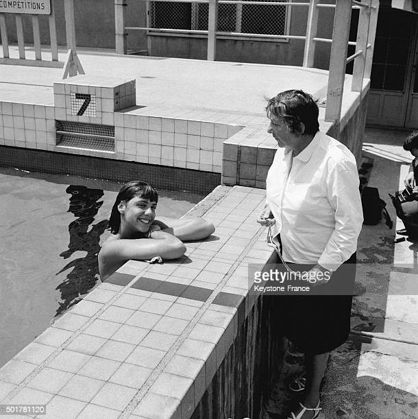 French champion swimmer Christine Caron during daily training session with her coach Suzanne Berlioux on July 18 1963 in Paris France