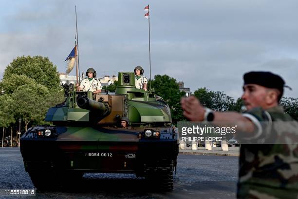 French Char Leclerc tank arrives prior to the Bastille Day military parade on the Champs-Elysees avenue in Paris on July 14, 2019.