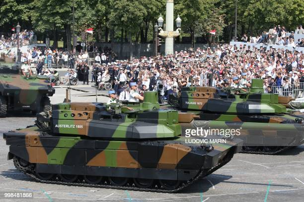 French Char Leclerc tanks of the 5th Dragoon Regiment , take part in the annual Bastille Day military parade on the Champs-Elysees avenue in Paris on...