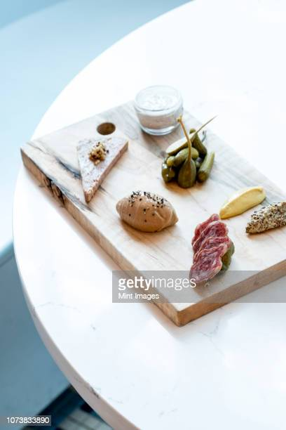 french charcuterie board with pickles, capers and mustard - charcuterie board stock pictures, royalty-free photos & images