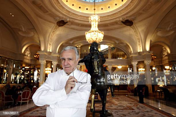French chef Alain Ducasse poses in the famous 'Hotel de Paris' in Monaco ahead of celebrations marking the 25th anniversary of his restaurant the...