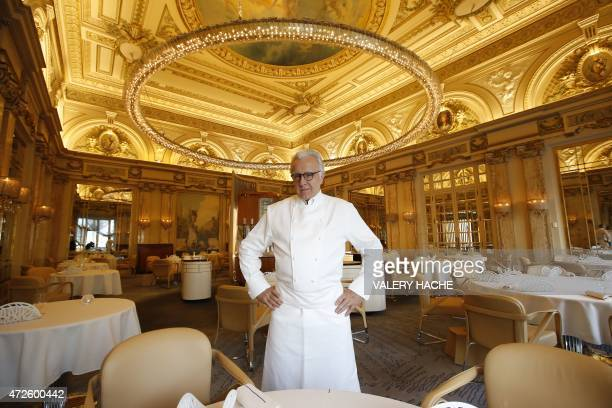 French chef Alain Ducasse poses in the 'Louis XV' new dining restaurant in the Hotel de Paris on May 8 2015 in Monaco AFP PHOTO / VALERY HACHE