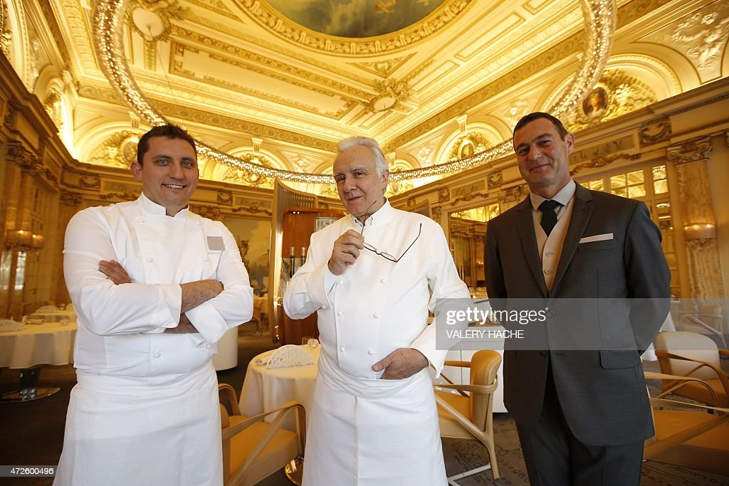 french chef alain ducasse c poses with kitchen manager dominique lory l and restaurant manager michel lang r in the louis xv new dining restaurant