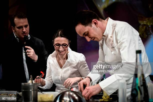 French Chef AnneSophie Pic and her executive chef Hugo Bourny take part in a cooking demonstration during the Omnivore culinary festival in Paris on...