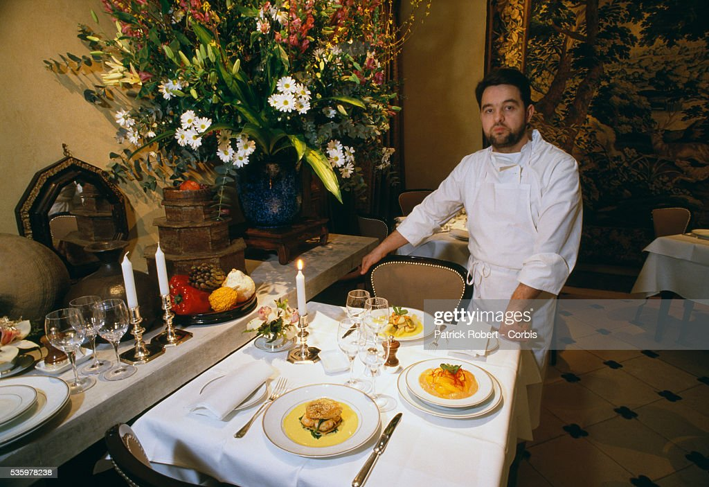 French chef Bernard Pacaud poses with several of his creations in his Paris restaurant L'Ambroisie. Pacaud has just been awarded a third Michelin star, the sign of prestige and quality for French chefs and restaurants.