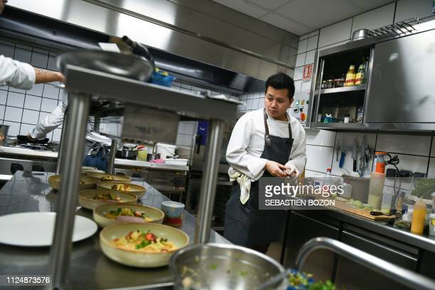 French chef Chatchai Klanklong works at his restaurant L'Orchidee on February 12 in Altkich eastern France Klanklong won his first star in the 2019...