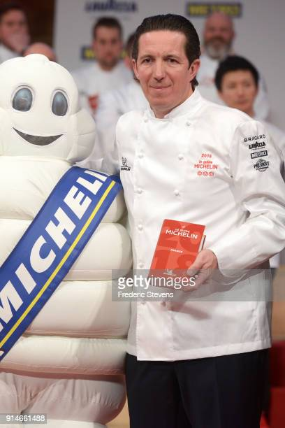 French chef Christophe Bacquie poses with the 2018 Michelin Guide during the Michelin Award Ceremony 2018 at Philharmonie De Paris on February 5 2018...