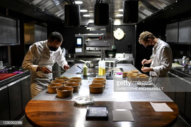 French chef Christophe Hay prepares take-away dishes at his restaurant 'La maison d'a cote' in Montlivault, a town located along the River Loire in...