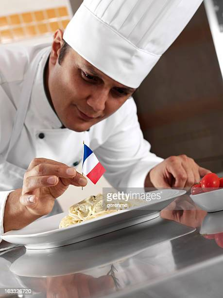 french chef completing pasta - french culture stock pictures, royalty-free photos & images