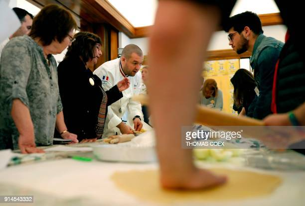 French chef Guillaume Gomez head chef at France's Elysee palace answers journalists question during a cooking class for teenage members of an Israeli...