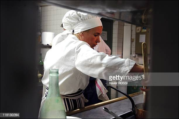 French chef Helene Darroze awarded 2 stars in the 2003 Michelin guide in Paris, France in February, 2003 - In her kitchen at rush hour. She has a...