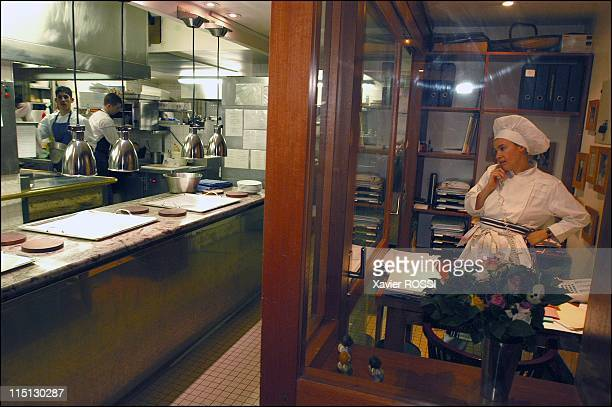 French chef Helene Darroze awarded 2 stars in the 2003 Michelin guide in Paris France in February 2003 Helene in the small personal office she has...