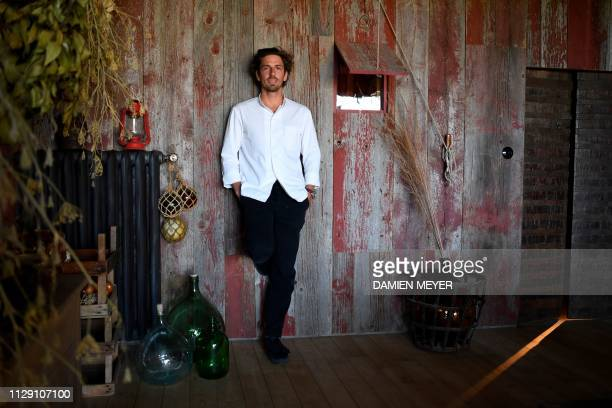 """French chef Hugo Roellinger, who was awarded two Michelin stars last January, poses at """"La ferme du vent"""" close to his restaurant """"Le Coquillage"""" in..."""