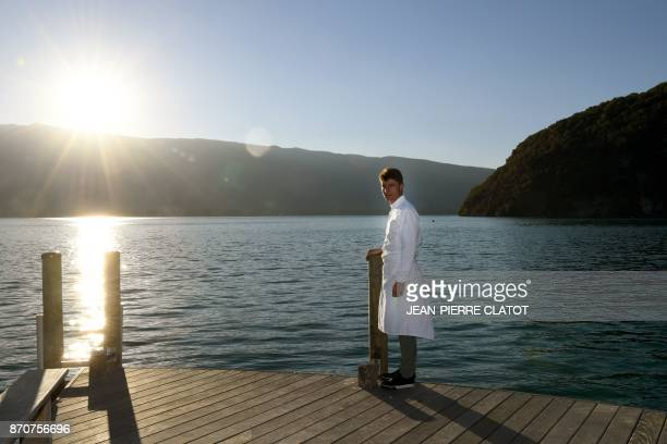 French chef Jean Sulpice poses near his restaurant 'L'Auberge du Pere Bise' in Talloires in the French Alps on October 12 2017 French chef Jean...
