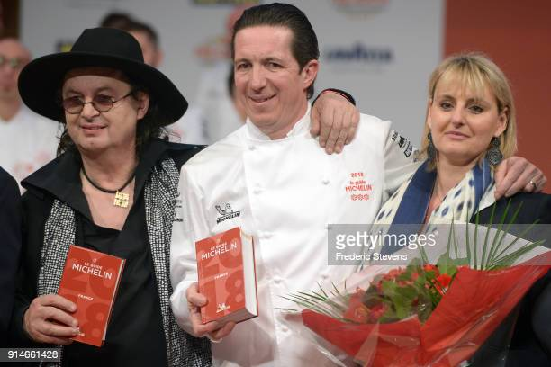 French chef Marc Veyrat Christophe Bacquie and his wife with the 2018 Michelin Guide during the Michelin Award Ceremony 2018 at Philharmonie De Paris...
